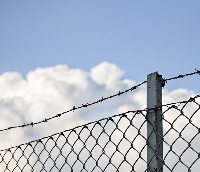 Barbed wire fence on a promise sky
